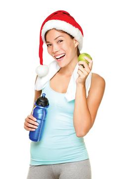 Uśmiechnięta kobieta, która dba o stan fizyczny i zdrowe odżywianie.